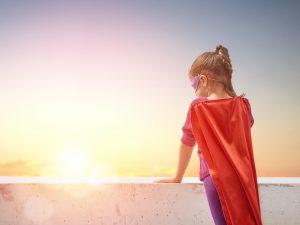 Mädchen als Superheldin